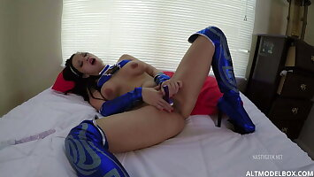 HOT COSPLAY CHICK WITH HIGH HEELS PLAYING WITH SEX TOYS